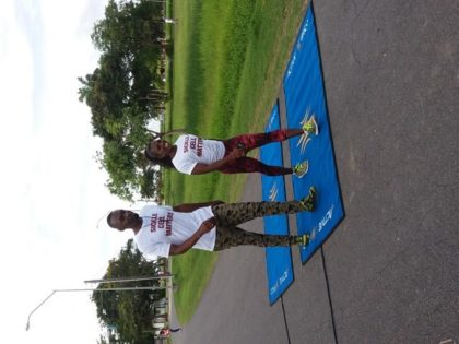 Director of Sport, Christopher Jones and Guyanese Gold Medalist, Alicia Fortune walking to raise awareness of Sickle Cell