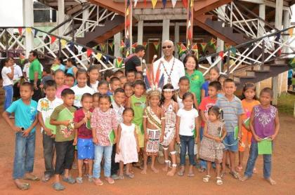 President David Granger and First Lady Mrs. Sandra Granger with the children of Surama Village who came out to greet them