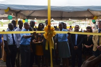 Officials of the TVET Department of the Ministry of Education, LTI, MACORP and the College of the North Atlantic cut the ribbon to officially open LTI's new automotive workshop