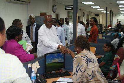 Finance Minister Winston Jordan meets a staff of the Guyana Revenue Authority during a visit to the agency