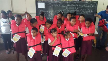 Primary and secondary students of Hururu School receiving life jackets as a collaborative effort between MARAD and Oldendorff