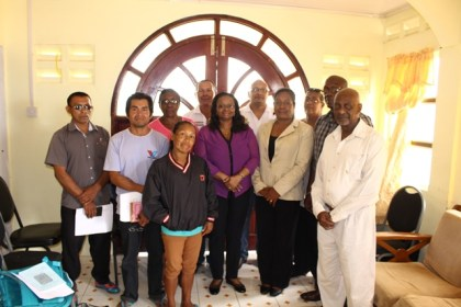 Minister of Social Protection Volda Lawrence, Minister within the Ministry, Keith Scott, Members of Parliament, Rajcoomarie Bancroft and Desmond Adams, and Chief Social Services Officer, Ricardo Banwarie flanked by members of the Region 8 Board of Guardians