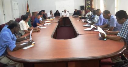 Minister Holder(centre of the head table) during his meeting with members of the Rice Assessment Committee