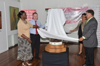 Left to right- Minister within the Ministry of Education, Nicolette Henry, CEO of Digicel, Kevin Kelly, Minister within the Ministry of Indigenous Peoples' Affairs, Valerie Garrido-Lowe and Minister of Indigenous Peoples' Affairs, Sydney Allicock unveiling a mini totem pole, a symbol of unity