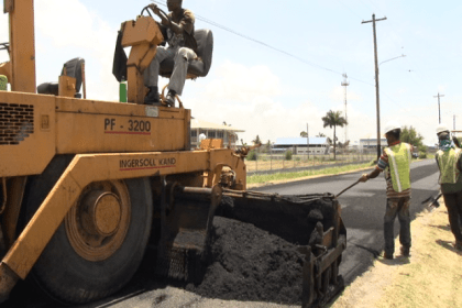 Contractors applying asphalt