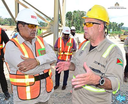 Prime Minister Moses Nagamootoo interacting with one of the executives of the Guyana Goldfields Inc, Aurora Gold Mine