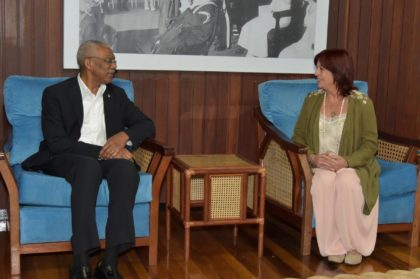 President David Granger shares a light moment with Ms. Perceval, during their meeting at the Ministry of the Presidency today.
