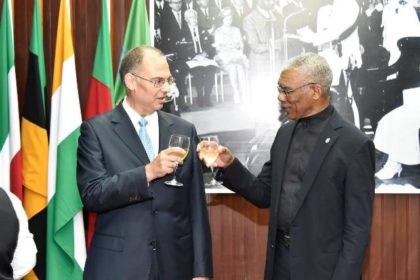 President David Granger shares a toast with Ambassador Kim Højlund Christensen after the accreditation ceremony, this morning at the Ministry of the Presidency