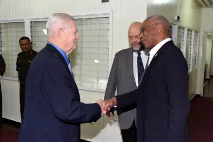 President David Granger greets Retired General Michael Carns, leader of the National Defense University's Capstone group in Guyana upon his arrival at the Ministry of the Presidency, earlier today.