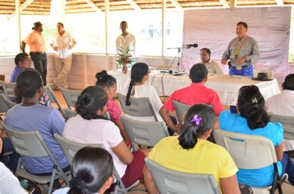 Minister of Indigenous Peoples' Affairs, Sydney Allicock addressing the residents at the meeting at Bina Hill