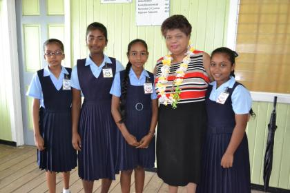 These Blairmont Primary School pupils were eager to meet Minister of Social Cohesion, Ms. Amna Ally. Top NGSA student, Ms. Sandyah Ramoo is pictured third from left