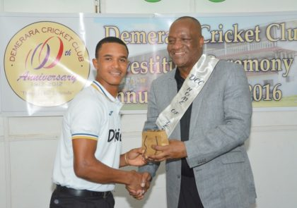 West Indies Under 19 Player, Tevin Imlach receiving his Award from Minister of State, Mr. Joseph Harmon during last evening's Awards Ceremony at the Demerara Cricket Club