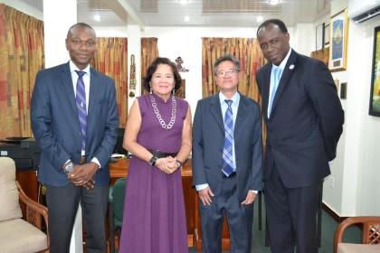 First Lady, Mrs. Sandra Granger is flanked by, from L-R : Mr. Dion Inniss, Caribbean Airlines' Guyana and Suriname Sales Representative; Mr. Tyrone Tang, Chief Executive Officer and Mr. Carl Stuart, South America Manager
