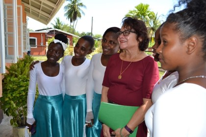 First Lady, Mrs. Sandra Granger delighted some members of the Tabernacle Moravian youth dance troupe when she agreed to pose for a photograph with them.