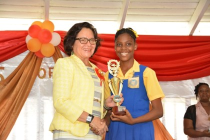 First Lady, Mrs. Sandra Granger presented the Most Outstanding Graduate Award to Ms. Jada Leitch