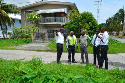 Community Coordinator, Ministry of Public Infrastructure, Neilson McKenzie, Deputy Mayor, Sherod Duncan, Councillor Alfred Mentore, Councillor Phillip Smith and Councillor Akeem Peter assessing the drainage at Bel Air Park