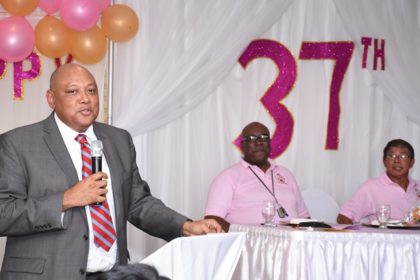 Minister of Natural Resources, Raphael Trotman addressing staff of GGMC at their anniversary celebrations. At the head table are GGMC's Acting Commissioner Newell Dennison and Chairman Stanley Ming