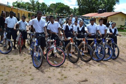 Some of the recipients display their brand new bicycles, which were donated under President David Granger's 'Five Bs' or 'Boats, Buses, Bicycles plus Breakfast and Books' Programme.
