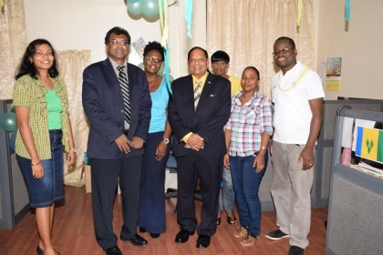 Prime Minister Nagamootoo and Minister of Public Security pose with staff at the St. Vincent exhibit during the CARICOM Culture Day activity, at the Ministry of Public Security.