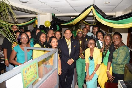 Prime Minister Nagamootoo and Minister of Public Security pose with staff at the Jamaica exhibit during yesterday's CARICOM Culture Day activity, at the Ministry of Public Security.
