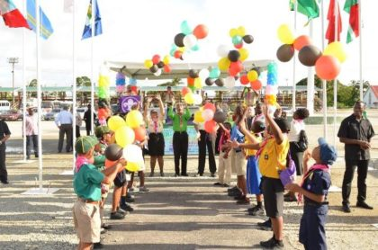 President David Granger (centre), Camp Chief, Ms. Zaida Joaquin (left) and Mr. Ramsay Ali, President of the Scouts Association of Guyana join some of the Cub Scouts as they release balloons to celebrate the opening of the 14th Caribbean Cuboree in Guyana and 100 years of Cuboree in the world.