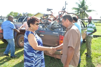 Social Cohesion Minister Amna Ally greets Toshao of Moco Moco, James George on her arrival at the Region Nine village