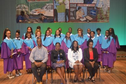 Minister within the Ministry of Education, Nicolette Henry (second from left), Permanent Secretary, Alfred King (right), and officials within the Ministry along with students who graduated from the Youth Entrepreneurial Skills Training Programme