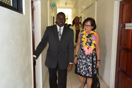 Pastor Exton Clarke of the Guyana Conference of Seventh-Day Adventists leads First Lady, Mrs. Sandra Granger through the halls of the Millicent Greaves Memorial Senior Citizens' Residence