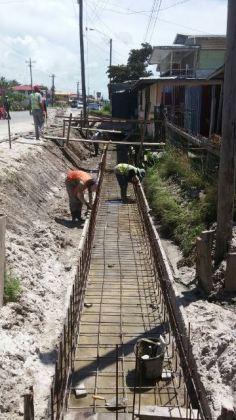 Contractors working on the West Coast Demerara road