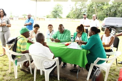 Minister of State, Joseph Harmon attending to residents' concern