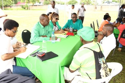 Minister within the Ministry of Natural Resources, Simona Broomes interacting with residents of the public at the outreach in Linden