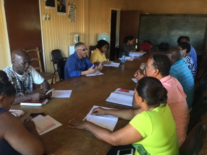 Minister Dominic Gaskin(second right, facing) speaking to the Councilors of the KNDC