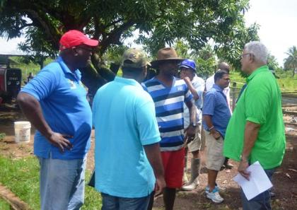 Agri. Minister Noel Holder, GLDA CEO Mr. Nigel Cumberbatch while engaging farmers during the outreach