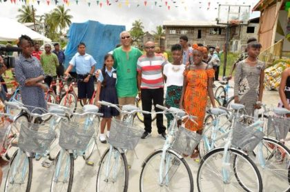 President David Granger with donor to the  'Five B's' programme,Mr. Divendra Jagroo and some of the recipients of bicycles.