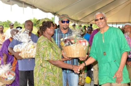 A resident of Ithaca village, Mahaica-Berbice receives a food hamper from President David Granger.