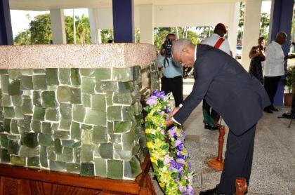 President David Granger lays a wreath at the Mausoleum in the Botanical Gardens where the late Linden Forbes Sampson Burnham was buried