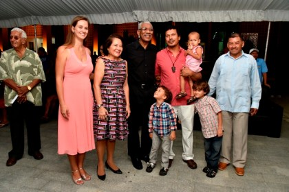 President David Granger and First Lady Mrs. Sandra Granger with Toshao Lenox Shuman and his family. Minister of Indigenous Peoples' Affairs, Mr. Sydney Allicock is at right