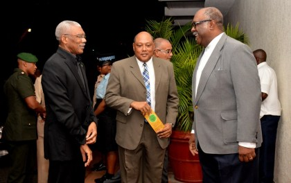 President David Granger shares a light moment with Minister of Natural Resources, Mr. Raphael Trotman (centre) and Commissioner (acting) of the Guyana Geology and Mines Commission (GGMC) Mr. Newell Dennison, upon his arrival at the Pegasus Hotel, earlier this evening