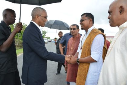 President David Granger being welcomed to the Blairmont Mandir for the prana pratistha ceremony of the Lord Hanuman Murti by Pandit Rajin Lallaram, this morning.