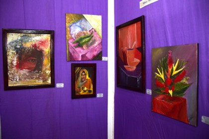 Some paintings on display at the Umana Yana at the Burrowes School of Art exhibition