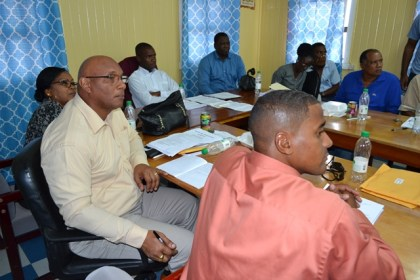 Bartica Mayor, Mr. Gifford Marshall and other councillors pay keen attention to Presidential Advisor on the Environment, Rear Admiral (ret'd) Gary Best as he makes his presentation.