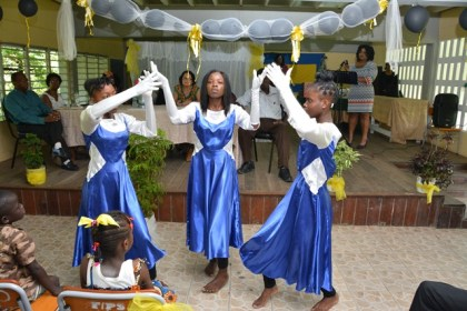 Three of the graduates from the ICT Training Programme performing an interpretive dance during  the Graduation Ceremony