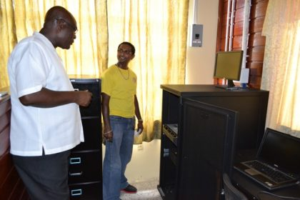 Mr. Roopesh Persaud, of the Upper Corentyne Industrial Training Centre, gives Presidential Advisor on eGovernment and Chief Executive Officer of the eGovernment Agency, Mr. Floyd Levi a closer look at the server that facilitates connectivity at the centre.