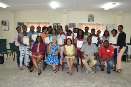 (Seated L – R) Col. Yvonne Smith,  General Secretary of the Guyana Red Cross Society, Mrs. Dorothy Fraser, First Lady, Mrs. Sandra Granger, First Aid Instructors Mr. Erwin Enmore and Mr. De Vaughn Lewis pose with participants of the workshop along with other instructors.