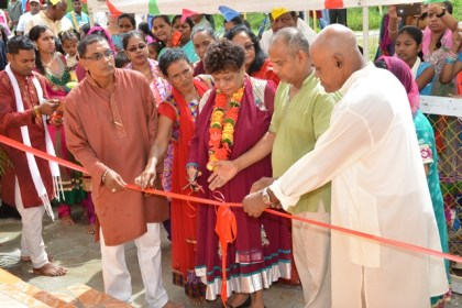 Minister of Social Cohesion, Ms. Amna Ally assisting in the cutting of the ribbon to officially mark the unveiling of  the Lord Hanuman Murti at Blairmont.