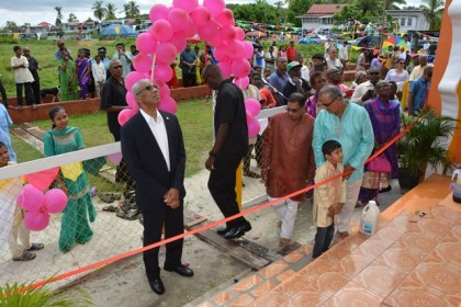 President David Granger looking up at the 4.5 metre murti