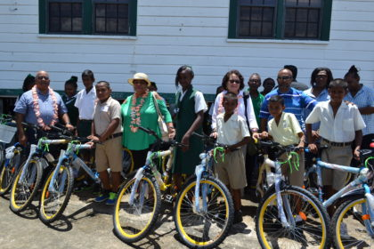 Recipients of the bicycles donated by the Guyana Bahamas Association pose with (L-R)  Regional Executive Officer, Mr. Dennis Jaikarran, Minister of Social Cohesion, Ms. Amna Ally, First Lady, Mrs. Sandra Granger and President of the Association Mr. Deavindra Jagroo