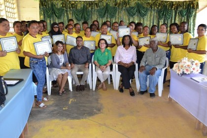Participants of the Self Reliance and Success in Business Workshop for Women proudly display their certificates with( seated L-R) Ms. Crystal Baptiste and Mr. Yohann Sanjay Pooran of Interweave Solutions, Colonel (ret'd) Yvonne Smith of the Office of the First Lady, First Lady, Mrs. Sandra Granger and Member of Parliament, Mr. Richard Allen.