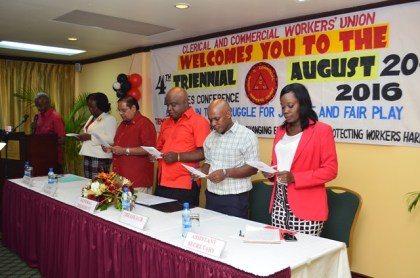 Executive members of the  Clerical and Commercial Workers Union  singing the union's song at the opening of the conference