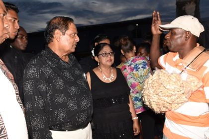 Prime Minister Moses Nagamootoo and Mrs. Sita Nagamootoo listen to the concerns of a Linden resident